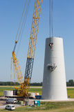 Dutch workers busy with the constuction of a new windturbine Royalty Free Stock Photography
