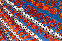 Dutch World Cup celebrations. Orange flags (Dutch national color) and footballs against a clear, blue sky during the world soccer cup 2014 Royalty Free Stock Photos