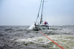 Dutch Yacht in misery be on tow. To a safe harbor Royalty Free Stock Image