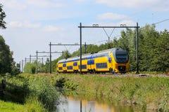 Dutch yellow and blue train Stock Photos