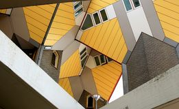 Dutch yellow cube houses in Rotterdam. Kubuswoningen, or cube houses, are a set of innovative houses built in Rotterdam in The Netherlands on Overblaak Street Stock Photo