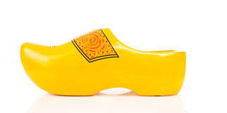 Dutch yellow wooden shoe Stock Photos