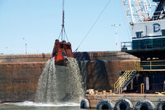 Dutra DB 24 dredging by the Port of Oakland. Oakland, CA - April 25, 2016: Dutra DB 24 dredging by the Port of Oakland. An average of 3-6 million cubic yards of Royalty Free Stock Photo