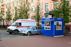 On duty on a city festival. Balashikha, Moscow region, Russia. Ambulance and security cars stand near the security booth with an inscription Security while on Royalty Free Stock Photography