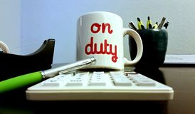 On Duty Coffee Mug in Office Stock Image