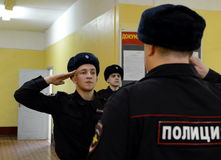 The duty of the company shall report to the officer. MOSCOW, RUSSIA - FEBRUARY 17, 2014:The duty of the company shall report to the officer Stock Photos