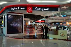 Duty free counter and shop at Dubai international airport. Dubai, United Arab Emirates - March 14, 2015: A Dubai Duty Free raffle ticket counter placed in front Stock Photos