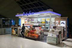 Duty free shop. BANGKOK – JANUARY 17. Employee in Duty-free store in Bangkok airport on January 17, 2012. Suvarnabhumi airport is world's 4th largest single Royalty Free Stock Images