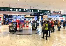 Duty Free Shop, passengers make purchases before departure in Milan Malpensa International Airport. Ferno, Milan, Italy - May 5, 2018: Duty Free Shop Royalty Free Stock Image