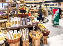 Duty Free Shop, passengers make purchases before departure in Milan Malpensa International Airport. Ferno, Milan, Italy - May 5, 2018: Duty Free Shop Royalty Free Stock Photo