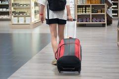Duty free shopping at airport. Woman at duty free shopp at airport stock photos