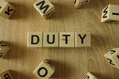 Duty word from wooden blocks. Dignity word from wooden blocks on desk royalty free stock photos