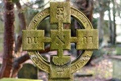 DUX LUX REX LEX Cross. Cross engraved with the words My Leader, My Light, My King, My Law in Bath, UK. The additional inscription of Jesu esto mihi Jesus roughly royalty free stock photos
