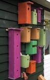 Duzi i mali barwioni birdhouses Zdjęcia Royalty Free