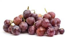 Duzi purpurowi winogrona na białym tle zdjęcia stock