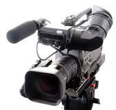 Dv camcorder. Isolated digital video camera recorder on tripod with white background Royalty Free Stock Photography
