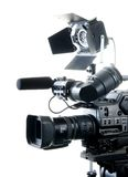Dv camcorder and light Royalty Free Stock Photo