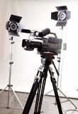 Dv camcorder and light. Black dv camera recorder on tripod and two spot lights in the studio Stock Photo