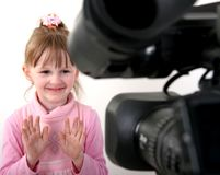 DV-camcorder shoot a girl. Stand dv-camcorder shoot a little girl in pink dress Stock Photography