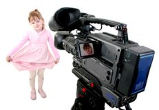 DV-camcorder shoot a girl. Stand dv-camcorder shoot a little girl in pink dress Royalty Free Stock Photo