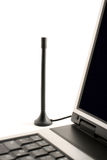 DVB-T Aerial next to Laptop. A small table antenna next to a laptop showing the concept of mobile television Royalty Free Stock Photo