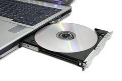 dvd抛出了现代的膝上型计算机 免版税库存照片