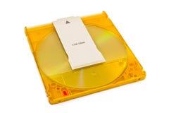 Dvd-ΚΡΙΟΣ δίσκος στην πλαστική κασέτα στο λευκό Στοκ φωτογραφία με δικαίωμα ελεύθερης χρήσης