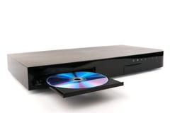 DVD, вставка диска КОМПАКТНОГО ДИСКА к DVD-плеер на белой предпосылке, изолированном конце-вверх, Стоковая Фотография