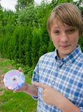 dvd привода мальчика Стоковая Фотография RF