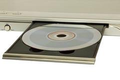 DVD-плеер с введенным крупным планом принятым диском Стоковые Фотографии RF