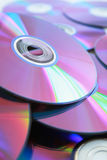 DVD. Background with several DVD with purple color Stock Photography