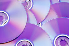 DVD. Background picture of colorful DVD disks stock photos