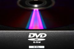 Dvd. A closeup photo of an ejected dvd drive stock photography