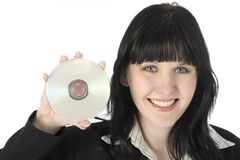 DVD. Beautiful happy business woman holding up DVD stock image