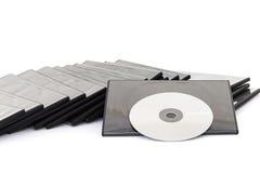 DVD-ask med disketten på vit bakgrund Fotografering för Bildbyråer