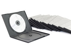 DVD-ask med disketten på vit bakgrund Arkivfoton
