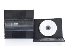 Dvd askar med disketten på vit bakgrund Royaltyfria Bilder