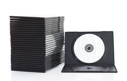 Dvd askar med disketten på vit bakgrund Royaltyfri Bild