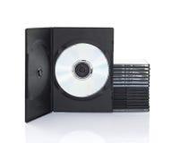 Dvd askar med disketten på vit bakgrund Arkivbild