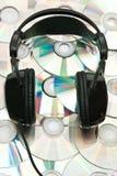 DVD background and headphones Stock Photos