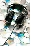 DVD background and headphones Royalty Free Stock Photos