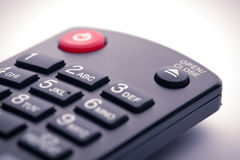 DVD or Bluray remote control. Remote control for a DVD or Bluray player. Focus on the open/eject button Stock Image