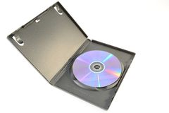 Dvd box. Dvd disk into a dvd box isolated on white background stock photography