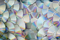 DVD CD disc pile technology background texture pattern Stock Image