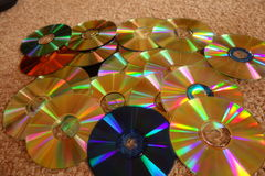 DVD and CD discs showing colorful backsides. Royalty Free Stock Photography