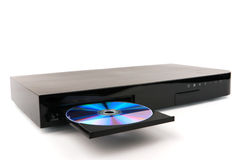 DVD, CD disk insert to dvd player on white background, close-up, isolated Stock Photography