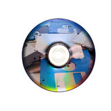 Dvd of CD en oude diskette binnen Stock Afbeeldingen