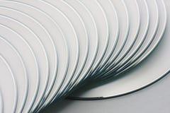 DVD/CD getrennt auf weißem Hintergrund Stockfotos