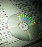 DVD. CD with its paper instruction stock photos