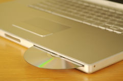 DVD/CD & Laptop Royalty Free Stock Photos